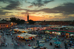 Jamaa el Fna (also Jemaa el-Fnaa, Djema el-Fna or Djemaa el-Fnaa. ) is a square and market place in Marrakesh's medina quarter (old city) with Koutubia in stock image