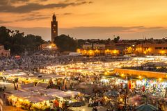 Jamaa el Fna market square in sunset, Marrakesh, Morocco, north Africa. Jamaa el Fna market square, Marrakesh, Morocco, north Africa. Jemaa el-Fnaa, Djema el Royalty Free Stock Image