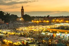 Jamaa el Fna market square in sunset, Marrakesh, Morocco, north Africa. Jamaa el Fna market square, Marrakesh, Morocco, north Africa. Jemaa el-Fnaa, Djema el stock photos