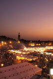 Jamaa el Fna square in Marrakech at sunset at Royalty Free Stock Images