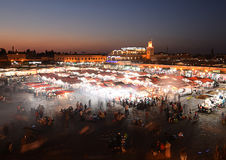 Jamaa el-Fna Square. The start of teh evening in the iconic Jamaa el-Fna Square from Marrakech royalty free stock photo