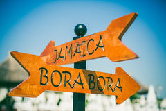 Jamaica and Bora Bora direction sign. On the beach royalty free stock photography
