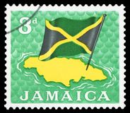 JAMAICA - Postage Stamp. JAMAICA - CIRCA 1964: Postage stamp printed in Jamaica, shows Map and flag, circa 1964 stock photography