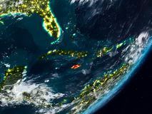 Jamaica on Earth at night. Jamaica from space on planet Earth at night with visible country borders. 3D illustration. Elements of this image furnished by NASA stock image