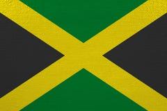 Jamaica flag on canvas. Patriotic background. National flag of Jamaica stock illustration