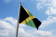Jamaica Flag with Clouds Royalty Free Stock Photos