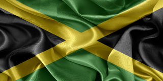 Jamaica flag. Jamaica satin flag On fabric texture Royalty Free Stock Photos