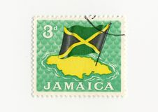 Jamaica flag stamp. An old stamp showing the jamaica island and its flag Royalty Free Stock Photo