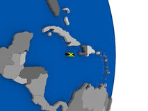 Jamaica on globe with flag Stock Images