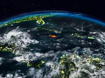 Jamaica at night. Jamaica from space at night on Earth with visible country borders. 3D illustration. Elements of this image furnished by NASA royalty free stock images
