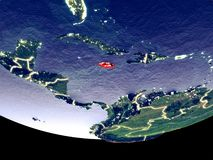 Jamaica at night from space. Satellite view of Jamaica from space at night. Beautifully detailed plastic planet surface with visible city lights. 3D illustration stock image