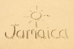 Jamaica. A picture of the word Jamaica and the sun drawn in the sand stock photo