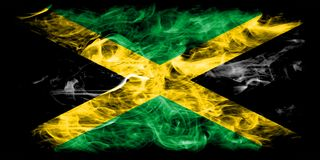 Jamaica rökflagga på en svart bakgrund Arkivfoto