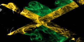 Jamaica rökflagga på en svart bakgrund Royaltyfri Foto