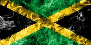 Jamaica rökflagga som isoleras på en svart bakgrund Arkivfoto