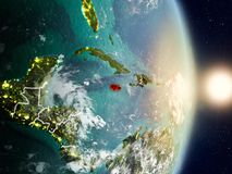 Jamaica during sunrise. Highlighted in red on planet Earth with visible country borders. 3D illustration. Elements of this image furnished by NASA stock images