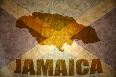 Jamaica vintage map. Jamaica map on a vintage jamaican flag background stock photo