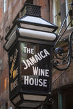 The Jamaica Wine House in London. LONDON, UK - AUGUST 25TH 2017: The traditional sign to the Jamaica Wine House located in St. Michaels Alley in the City of Royalty Free Stock Images