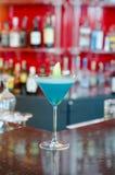 Jamaican Blue Cocktail. Served on a bar shelf Stock Photos