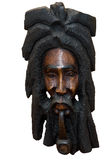 Jamaican carving. Of a man smoking a pipe on a white background royalty free stock image