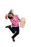 Jamaican child jumping with christmas gift Royalty Free Stock Image