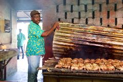 Jamaican cook showing jerk chicken cooking Royalty Free Stock Images