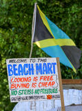 Jamaican flag at a beach market with sign Royalty Free Stock Photo