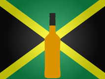 Jamaican Flag with a Bottle of Rum Stock Photography