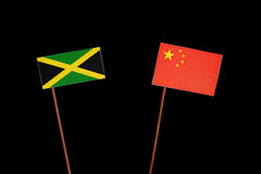 Jamaican flag with Chinese flag on black. Background stock image