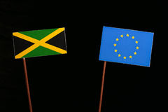Jamaican flag with European Union EU flag on black. Background royalty free stock photos
