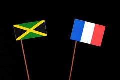 Jamaican flag with French flag isolated on black. Background stock photography