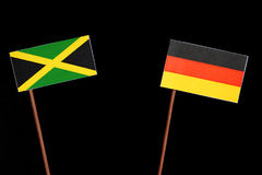 Jamaican flag with German flag on black. Background stock photos