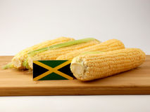 Jamaican flag on a wooden panel with corn isolated on a white ba. Ckground stock photography