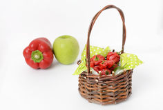 Jamaican red hot peppers in a basket. On white backgroud, vertical composition Royalty Free Stock Image
