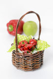 Jamaican red hot peppers in a basket. On white backgroud, vertical composition Royalty Free Stock Photos