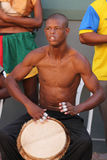 Jamaican Street Performer Playing Bongo Drums. FALMOUTH, JAMAICA, MAY 11: An unidentified street performer playing outside the port of Falmouth on MAY 11, 2011 Stock Photography