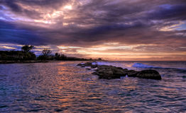 Jamaican sunset and rocks (HDR) Royalty Free Stock Photography