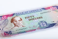 Jamaikan 50 dollar sedel, vit bakgrund Royaltyfri Fotografi