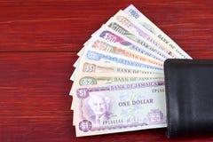Jamaikanska pengar i den svarta plånboken