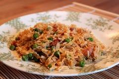 Jambalaya,pilaf,fried rice. With green peas, smoked sausage, and onions stock photos