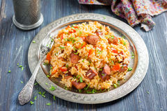 Jambalaya. Spicy rice with smoked sausage and red pepper. On a round metal tray Stock Images