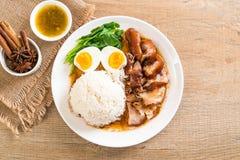 Jambe cuite de porc avec du riz Photo stock