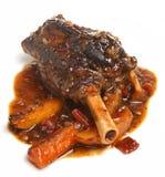 Jambe d'agneau avec les légumes rôtis Image stock