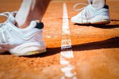 Jambe de joueur de tennis Photographie stock libre de droits