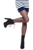 Jambes attrayantes de femme dans les bottes Photo libre de droits
