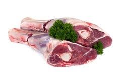 Jambes crues d'agneau d'isolement Image libre de droits