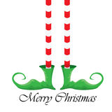 Jambes d'elfs de bande dessinée de Noël sur le fond blanc Image stock
