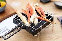 Jambes de crabe dans le restaurant photos stock
