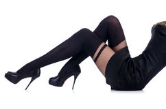 Jambes de femme avec des bas Photos stock