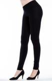 Jambes de femme avec des guêtres Image stock